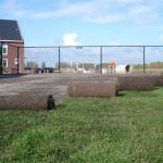 Uitrollen van graszoden